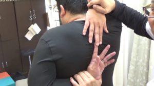 石川県金沢市背中で指がつく